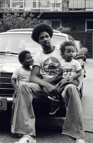 Julius Erving Relaxing With His Children