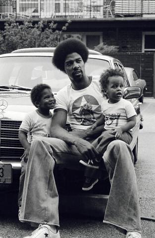 Julius Erving Relaxing With His Children